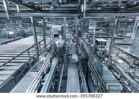 Equipment for brewing beer in motion on the plant territory. - stock photo