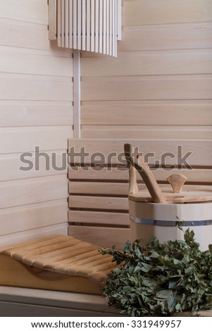 Equipment for sauna in light wooden cozy interior. - stock photo