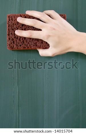 Erasing the Blackboard - stock photo