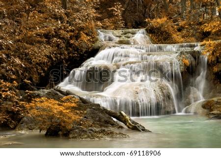 Erawan Waterfall in autumn - stock photo