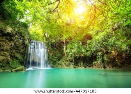 Erawan Waterfall is a beautiful waterfall in spring forest in Kanchanaburi province, Thailand. - stock photo