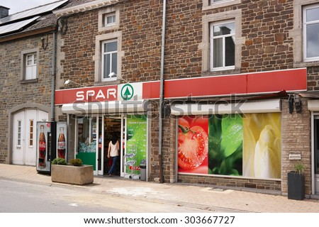 EREZEE, BELGIUM - JULY 28 : SPAR supermarket's entrance. Spar is a Dutch multinational retail chain operates as independent or franchise in 35 countries worldwide. Taken in Belgium on July 28, 2015 - stock photo