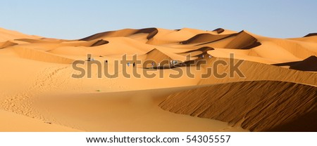 erg chebbi dunes in morocco - stock photo