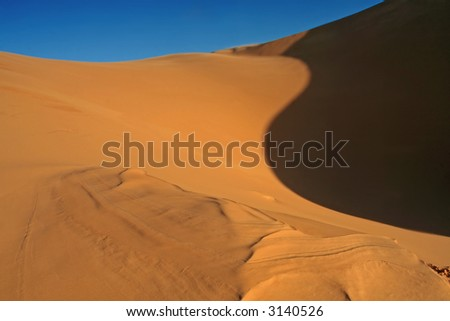 Erg Chebbi sand dunes in the Sahara Desert (Hassi Labiad and Merzouga, Morocco). Algeria is located 20 km from here. - stock photo