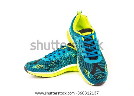 Ergonomic comfortable designer sport shoes in brigh colors over white background - stock photo