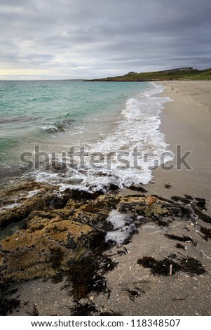 Eriskay beach and rocks in the Outer Hebrides - stock photo