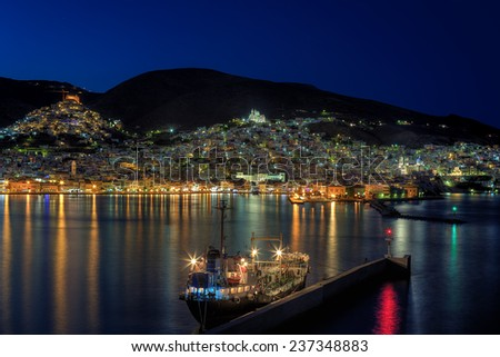 Ermoupolis and Ano Syros on the Greek island of Syros, Cyclades, viewed at dusk - stock photo