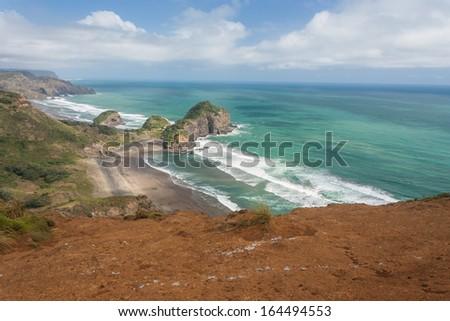 eroded cliffs on New Zealand coast - stock photo