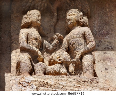 Erotic act depicted in beautifully carved sculptures, Sun temple, Konark - stock photo