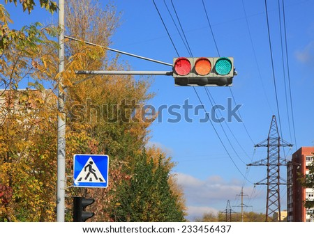 Error of traffic light. A traffic light with all three lights lit simultaneously - stock photo