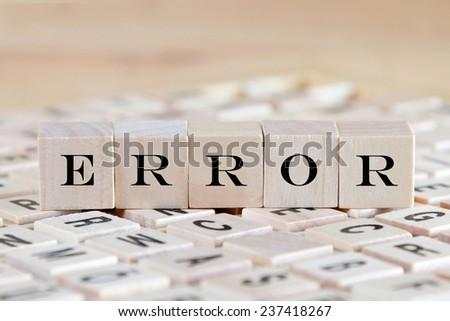 error word background on wood blocks - stock photo