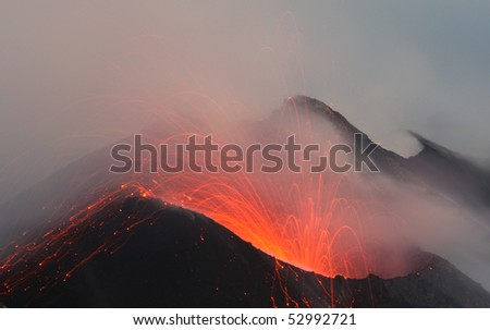 Erupting crate at Stromboli in the fog - stock photo