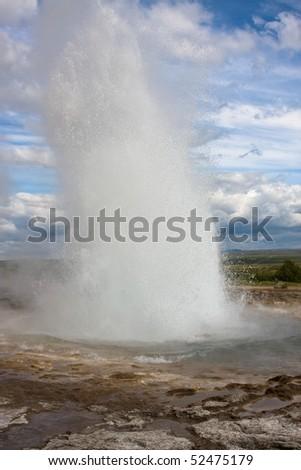 Erupting geyser - stock photo