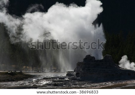 Eruption of Castle geyser in Yellowstone National Park - stock photo