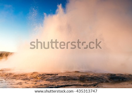 Eruption of Founain Geyser in the evening light, Yellowstone National Park, Wyoming, USA - stock photo