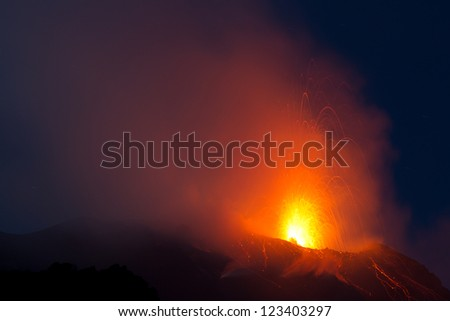 eruption of volcano at night - stock photo