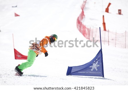"""Erzurum, Turkey - March 25, 2016 : Snowboarder rides the slope during the Unilig University winter competitions on March 25, 2016 in Erzurum, Turkey."""" - stock photo"""