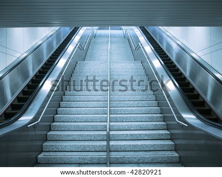 Escalator and stair - stock photo