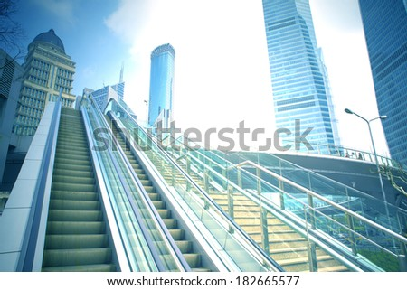 escalator at an outdoor shopping mall  - stock photo