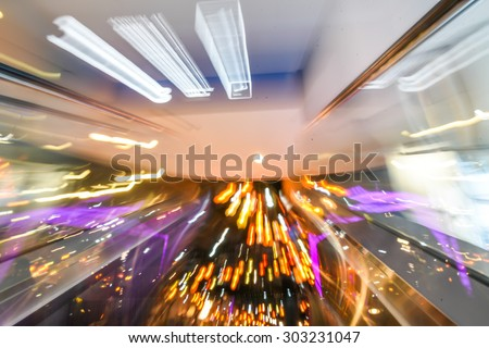 escalator - blurred motion - stock photo