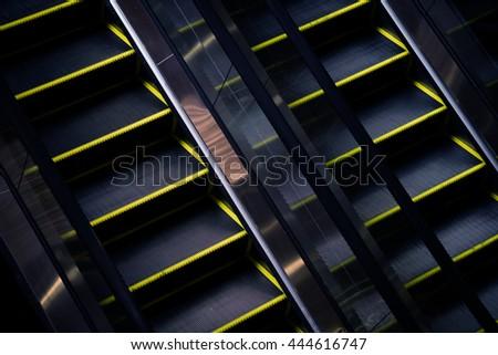 Escalator closeup, mall interior, low light  - stock photo