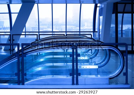 Escalator enter in violet corridor in office centre - stock photo
