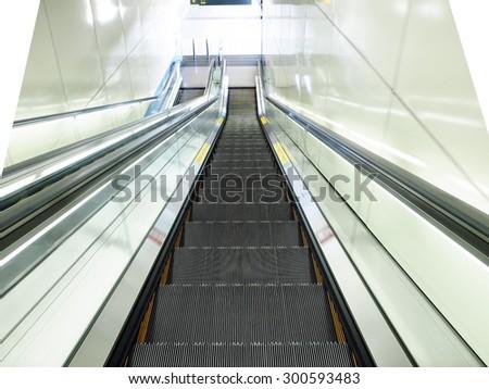 Escalator going down - stock photo