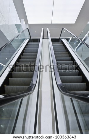 Escalator in a modern interior with stainless steel - stock photo