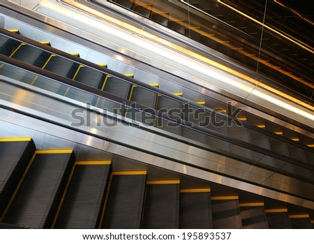 Escalator in a shopping mall - stock photo
