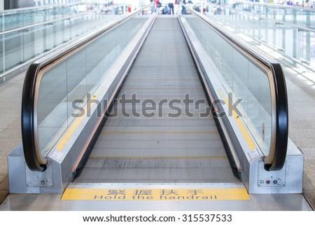 Escalator in Hong Kong International Airport - stock photo