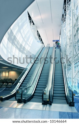 Escalator in Modern Airport - stock photo