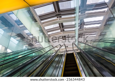escalator in modern building ,abstract space with skyscraper  - stock photo