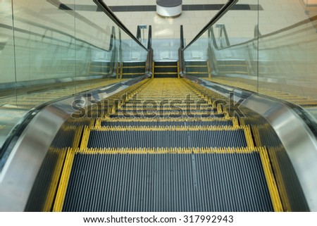 escalator in modern office building - stock photo