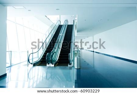 Escalator in modern office building. - stock photo