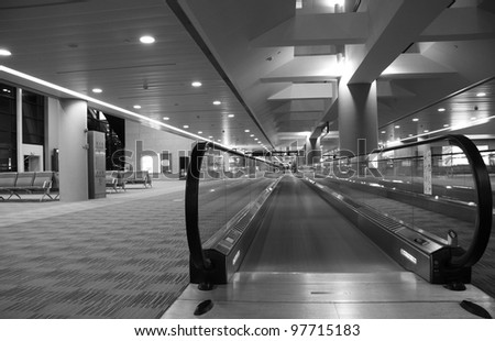 escalator in the airport,grey toning. - stock photo