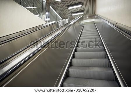 Escalator, modern stairs - stock photo