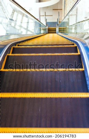 Escalator or moving staircase in modern architecture - stock photo