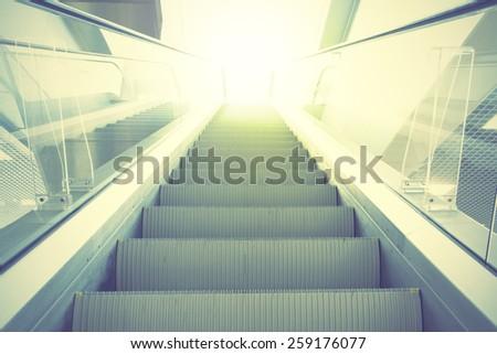 Escalator. Retro style filtred image - stock photo