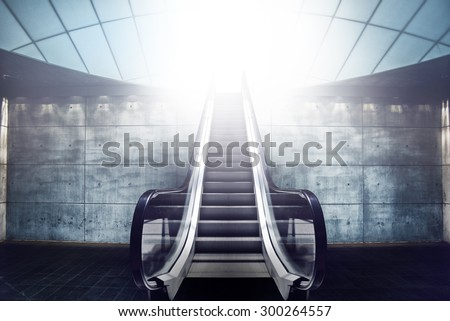 Escalator Staircase and Exit to Light, Modern Concrete Architecture Interior - stock photo