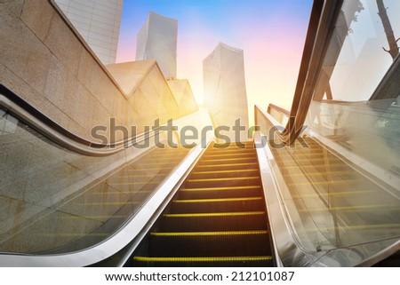 escalator to office building - stock photo