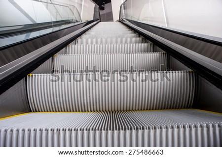 escalator,Up and down escalators in public building.,escalator in modern office building - stock photo