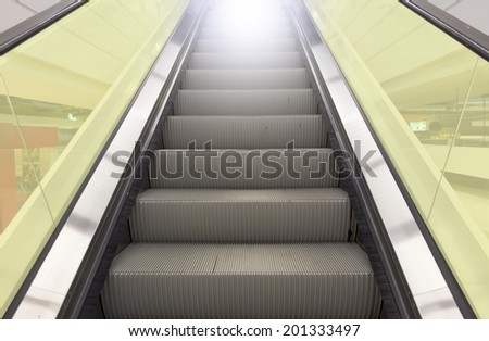 Escalator with yellow glass.  - stock photo