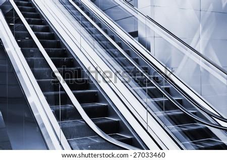 Escalators in modern hall of beijing airfield. - stock photo