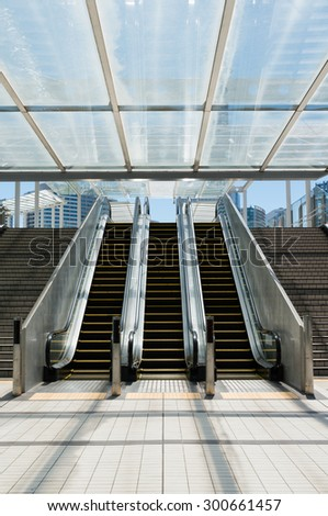 Escalators in the concourse. Symmetrical composition of moving stairways. - stock photo