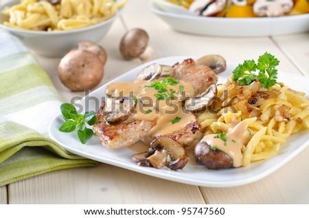 Escalope chasseur with spaetzle - stock photo