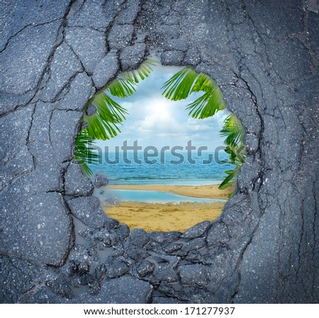 Escape city stress vacation dreaming as a dirty road pothole with the magical reflection of a tropical beach paradise scene as a metaphor for leisure holiday break from urban decay anxiety. - stock photo