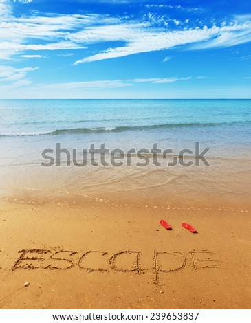 Escape message on the beach sand - vacation and travel concept - stock photo