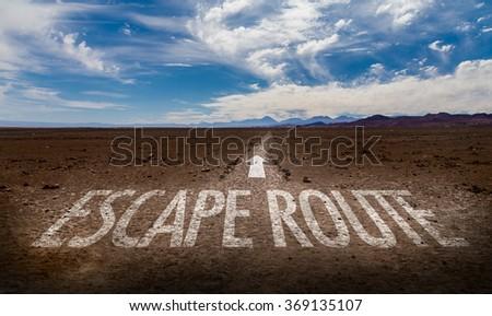 Escape Route written on desert road - stock photo