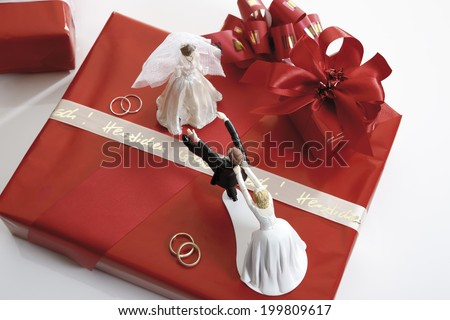 Escaping bride groom figurine - stock photo