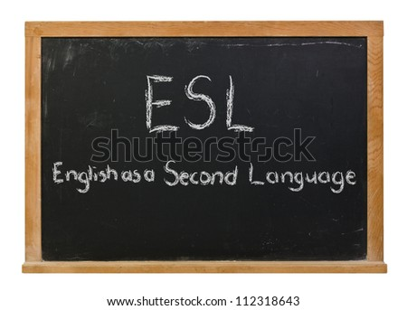 ESL written in white chalk on a black chalkboard - stock photo